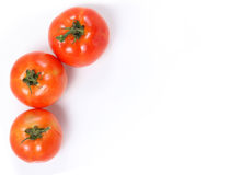 Tomatoes. Whole and  half on white Royalty Free Stock Image
