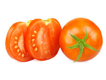 Tomatoes, whole and sliced. Royalty Free Stock Photography