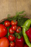 Tomatoes in a wicker basket Stock Photos