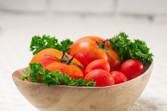 Tomatoes on a wood bowl Stock Photography
