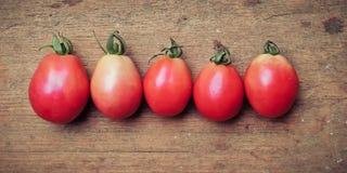 Tomatoes on wood Stock Image