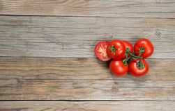 Tomatoes on wood Royalty Free Stock Image