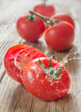 Tomatoes on wood Stock Photo