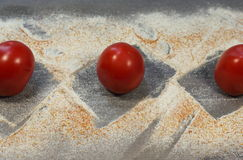 Tomatoes on the wood texture Stock Photography