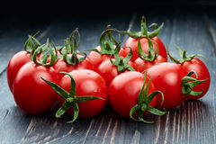 Tomatoes on wooden background Stock Image