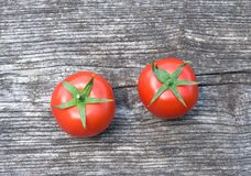 Tomatoes on wooden background Stock Photography