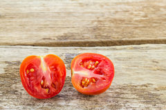 Tomatoes on wooden background Stock Images