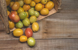 Tomatoes on a wooden background Royalty Free Stock Image