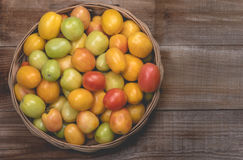 Tomatoes on a wooden background Royalty Free Stock Images