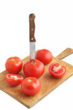 Tomatoes on wooden board Stock Photo