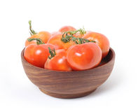 Tomatoes in wooden bowl Stock Photos