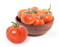 Tomatoes in wooden bowl Stock Photography