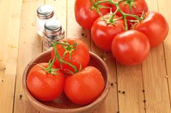 Tomatoes in wooden bowlin Stock Images