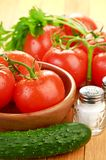 Tomatoes in wooden bowlin Royalty Free Stock Image