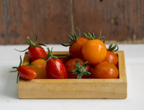 Tomatoes in a wooden box. Close up royalty free stock images