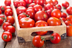 Tomatoes in a wooden box Royalty Free Stock Image