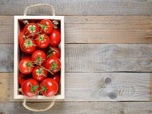 Tomatoes in wooden box on table Royalty Free Stock Photography