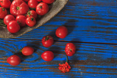 Tomatoes in wooden buckets Stock Photos