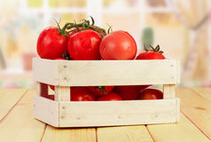 Tomatoes in wooden crate Royalty Free Stock Photo