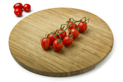 Tomatoes on Wooden Cutting Board. Studio Shot Stock Image