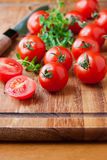 Tomatoes on wooden cutting board Royalty Free Stock Photography