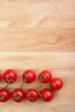 Tomatoes on the wooden desk Stock Images