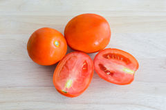 Tomatoes on wooden kitchen table. Red Tomatoes on wooden kitchen table royalty free stock image