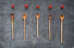 Tomatoes and wooden spoons Royalty Free Stock Photography