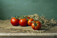 Tomatoes on wooden table Stock Photo