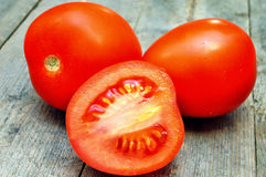 Tomatoes. On the wooden table royalty free stock photography
