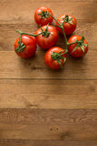 Tomatoes on wooden table.  Royalty Free Stock Image