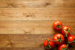 Tomatoes on wooden table.  Royalty Free Stock Photos