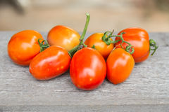 Tomatoes on wooden table. Fresh tomatoes on wooden table Royalty Free Stock Images