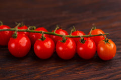 Tomatoes on a wooden table Stock Image