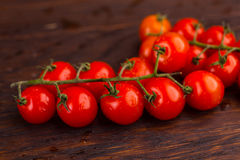 Tomatoes on a wooden table Stock Photo