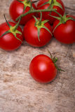 Tomatoes on a wooden table Royalty Free Stock Image