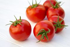 Tomatoes. On a wooden white background Royalty Free Stock Images
