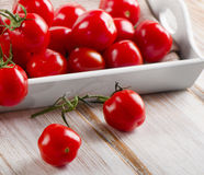 Tomatoes in a wooden white box Royalty Free Stock Photo