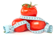 Tomatoes wrapped with measuring tape Stock Photos