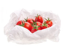 Tomatoes wrapped in paper Royalty Free Stock Images