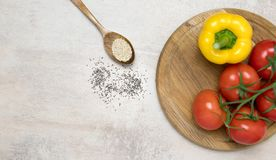 Tomatoes and yellow pepper on wood. royalty free stock photos