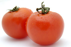 Tomatos. On the white background Stock Photo