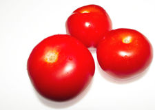 Tomatos. Three tomatoes Royalty Free Stock Photography
