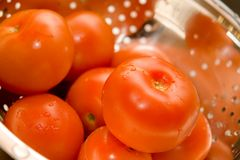 Tomatos. Close-up of fresh tomatos in silver strainer Royalty Free Stock Image