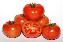 Tomatos. Group of whole and half tomatos Stock Photos