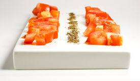 Tomatos and basil. Photo of an italian appetizer, tomatos, salt and pepper, basil, olive oil Stock Photo