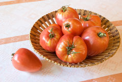 Tomatos in basket Stock Photo