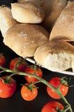 Tomatos and breads Stock Photos