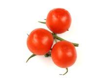 Tomatos cherry. Cherry tomatos over white background Royalty Free Stock Photography