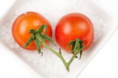 Tomatos cherry. Cherry tomatos on the sea salt Stock Image